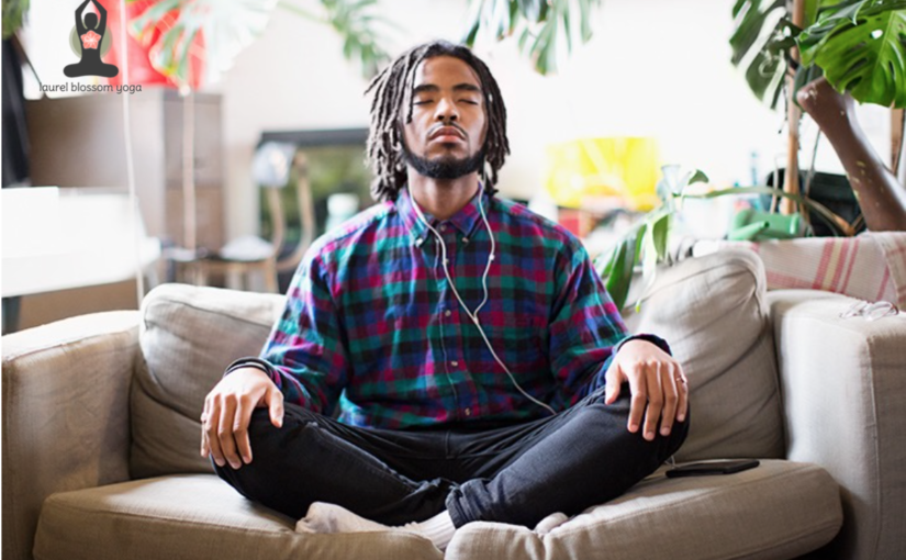 male meditating using smartphone app